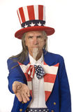 Uncle Sam Want's Your Money. Uncle Sam on a white background with his palm outstretched stock photo