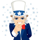 Uncle Sam Wants You. Old man disguised as Uncle Sam representing wants you concept with pointing hand and stars on background Royalty Free Stock Photography