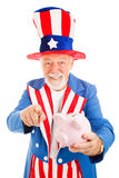 Uncle Sam Wants Your Cash. Realistic Uncle Sam holding a piggy bank and asking for donations. Isolated on white stock images