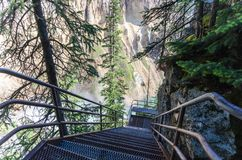 Uncle Tom`s Trail in Yellowstone National Park consists of very steep stairs to get to the Lower Yellowstone Falls. Uncle Tom`s Trail in Yellowstone National stock images