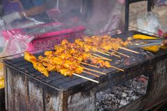 Unhealthy dirty smoke street food in Thailand. Unclean charcoal chicken stick meat grill unhealthy dirty smoke street food cause of cancer Royalty Free Stock Photos