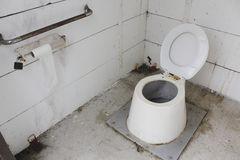 Unclean Public Washroom. A poorly maintained public washroom is unwelcoming and neglected Royalty Free Stock Photos