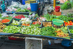 Unclean vegetable sale food rural street market in Asia. Royalty Free Stock Photos