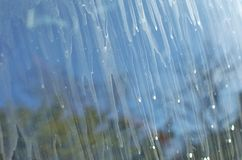 Unclean Window. Dirty window with water smudges Royalty Free Stock Photo