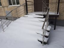 Uncleaned porch and stairs in the snow stock photo