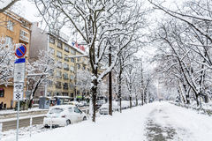 Uncleaned sidewalk and street with snow in Sofia Stock Images