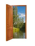 Unclosed wooden door with a kind on beautiful nature Stock Photo