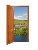 Unclosed wooden door with a kind on rural landscape Royalty Free Stock Photos