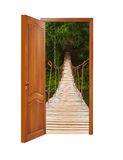 Unclosed wooden door with a kind on the wooden suspended bridge Stock Photography