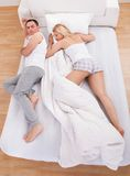 Uncomfortable Husband Sleeping Royalty Free Stock Photo