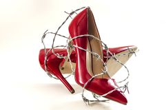 Free Uncomfortable Shoes, Sexism In Fashion And Foot Pain Concept With High Heel Stilettos Wrapped In Barbed Wire Representing The Royalty Free Stock Photos - 139928028