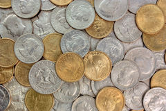 Uncommon Coin Assortment - United States. An assorted pile of United States coins including various half dollar, Susan B Anthony dollar, silver dollar, and gold Royalty Free Stock Photo