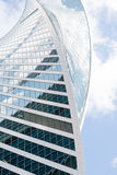 Uncommon high-rise building on blue sky Royalty Free Stock Photos