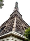 Unusual look on Eiffel Tower. Uncommon and original perspective on Eiffel Tower in Paris in France. View from the corner on edge Royalty Free Stock Images
