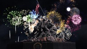 Uncommon Valor Fireworks. This video features the Uncommon Valor memorial statue with flag snapping in the wind and fireworks bursting in the background stock video