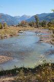 Uncompahgre River near Ridgway. High country stream runs through early autumn countryside near Ridgway, Colorado with peaks of the San Juan Mountain Range in the Royalty Free Stock Images