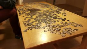 Uncomplete puzzle on wooden table Stock Photos