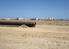 Uncompleted gas line. Gas pipeline against blue sky Royalty Free Stock Photos