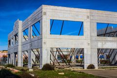Uncompleted Office Building Shell With Bracing. Uncompleted Outer Concrete Frame Work And Metal Bracing For Office Building Stock Photos
