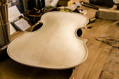 Uncompleted violin Stock Images
