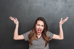 Uncomprehending screaming woman looking at the camera Royalty Free Stock Image