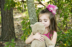 Unconditional Love. Beautiful child  hugging and looking affectionately with  her very best friend and playmate Royalty Free Stock Images