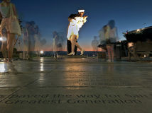 Unconditional Surrender Statue surrounded by tourists Royalty Free Stock Photo