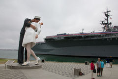 Unconditional Surrender statue with USS Midway Royalty Free Stock Photo