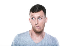 Unconfident and worried young man Stock Image