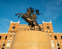 Unconquered statue Stock Images