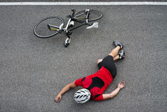 Unconscious cyclist in the road. Space for text Royalty Free Stock Images