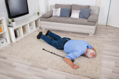Unconscious Disabled Man Lying On Carpet Royalty Free Stock Images