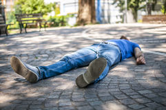 Unconscious guy. After heart attack in the outdoor Royalty Free Stock Image