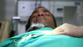 Unconscious male patient on an operating table stock video