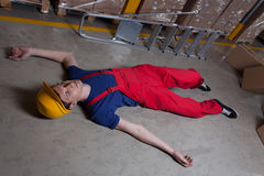 Unconscious man in a factory. Unconscious man on the floor in a factory Stock Images