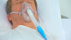 An unconscious man laying on his bed. At the hospital stock footage