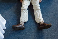 Unconscious man lying on rug Royalty Free Stock Photography
