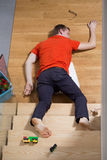 Unconscious man. Young unconscious man lying down on the stairs Royalty Free Stock Image