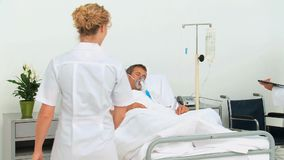 Unconscious patient receiving a visit stock footage