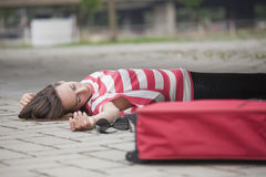 Unconscious woman on asphalt road. Unconscious woman lying on asphalt road Royalty Free Stock Photography