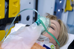 Unconscious Woman With Oxygen Mask Royalty Free Stock Photos