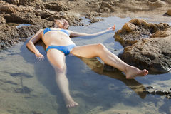 Unconscious woman in water Stock Photos