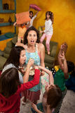 Uncontrollable Little Girls. Shocked mother among wild little girls at a sleepover royalty free stock photography