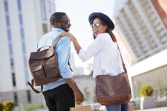 Unconventional handsome guy making purchases with his girlfriend royalty free stock photo