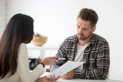 Unconvinced skeptical client looking doubtful about deal listeni. Unconvinced skeptical client looking doubtful about rejecting deal listening to manager royalty free stock photos