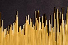 Uncooced spaghetti. On black background stock photo