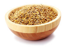 Uncoocked barley in plate isolated Royalty Free Stock Images