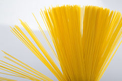 Uncoocked italian spaghetti closeup. Closeup of uncooked spaghetti noodles royalty free stock photos