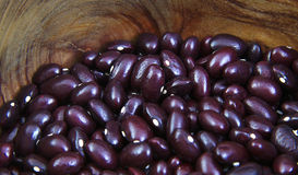 Uncoocked red beans in a olive wood bowl. Gernika Royalty Free Stock Photos