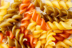Uncook fusilli background. Royalty Free Stock Image